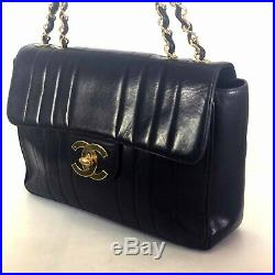 Authentic Chanel Black Veritcal Quilted Lambskin Leather Jumbo Flap Bag
