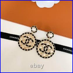 Chanel pearl earring with black skin