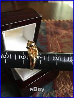 Genuine 18kt gold Cartier panther ring. Emerald eyes. Onyx nose. MIB