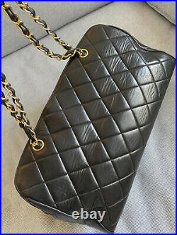 Vintage CHANEL Black Quilted Duffle Shoulder Bag with Gold Chain