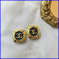 Vintage CHANEL clip on earrings Made In France Black And Gold Logo